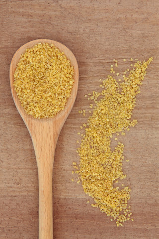 http://www.dreamstime.com/stock-image-bulgur-wheat-cereal-wooden-spoon-over-papyrus-background-image29922581